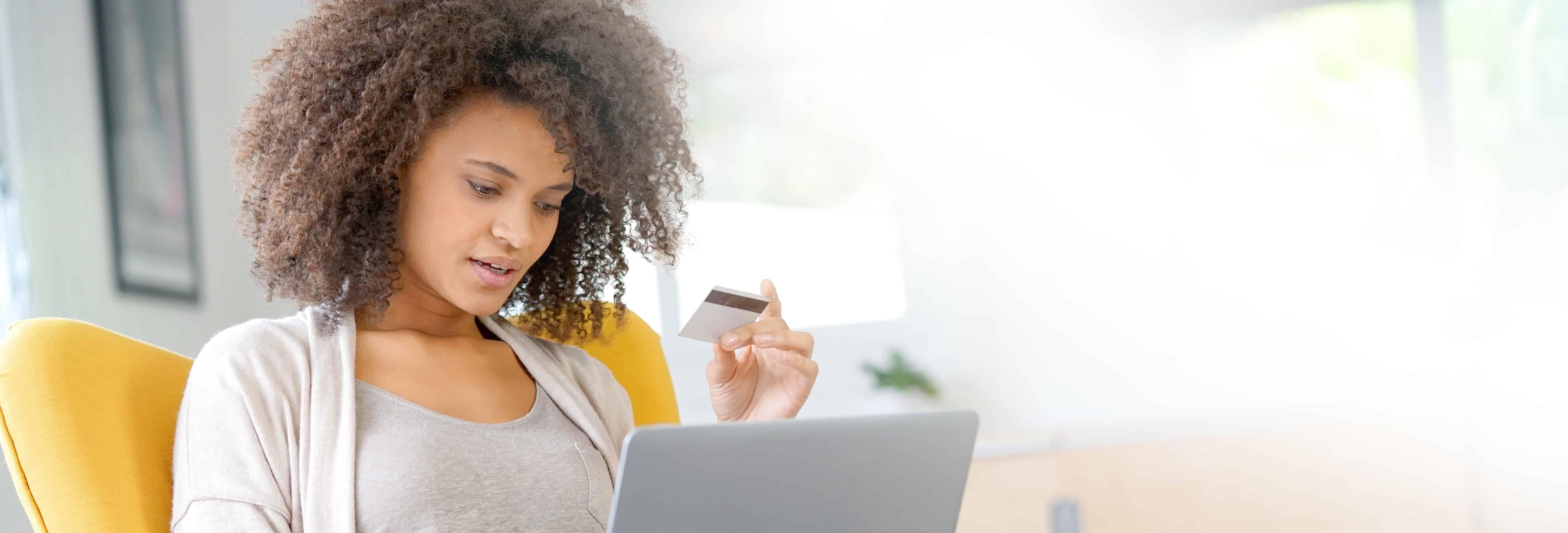 Beautiful mixed race woman shopping on internet